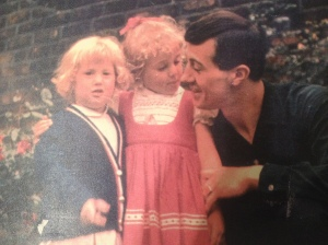 My sister, Helen, and me, with our father, aged about 3 and 5.